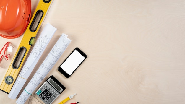 Flat lay of architect desk with phone Free Photo