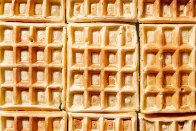 Flat lay of arranged waffles with pattern Free Photo