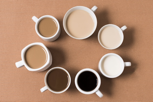 Flat lay arrangement of delicious coffee types Free Photo