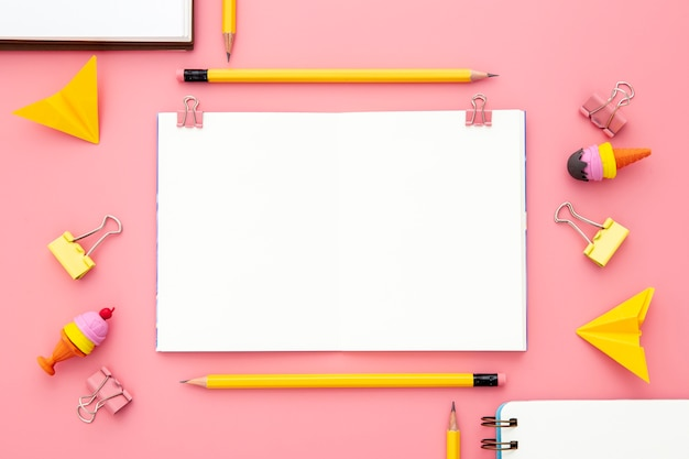Flat lay arrangement of desk elements on pink background Free Photo