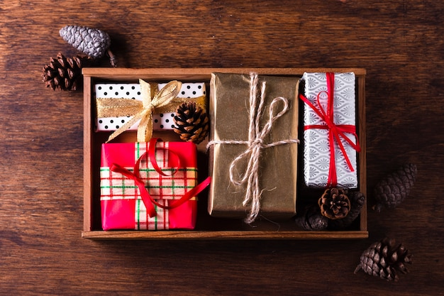 Flat lay arrangement of different colorful christmas gifts Free Photo