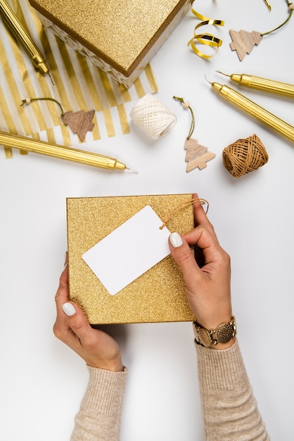 Flat lay arrangement of gift boxes and wrapping paper Free Photo