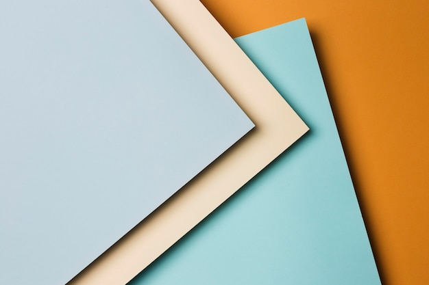 Flat lay arrangement of multicolored paper sheets Free Photo