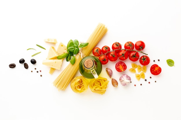 Flat lay arrangement of uncooked pasta and ingredients Free Photo