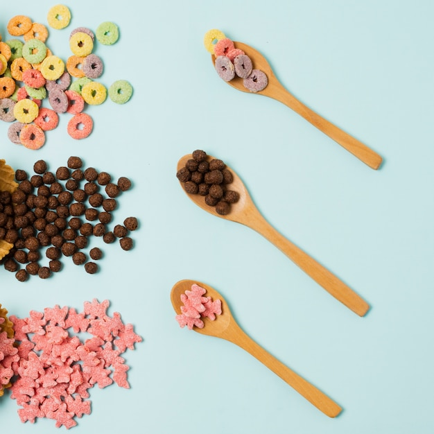 Flat lay arrangement with cereals and wooden spoon Free Photo