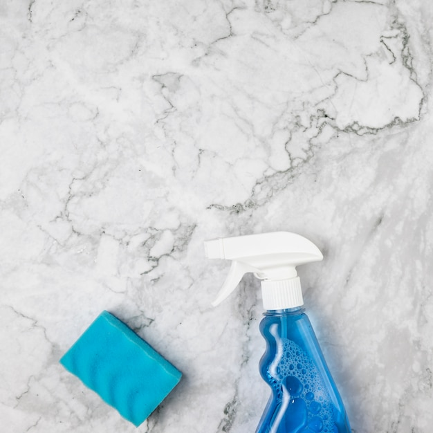 Flat lay arrangement with cleaning items Free Photo