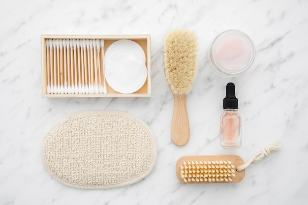 Flat lay arrangement with cosmetics on marble table Free Photo