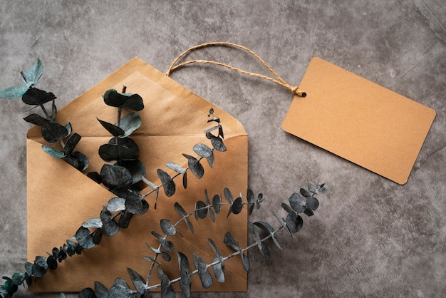 Flat lay arrangement with envelope and twig Free Photo