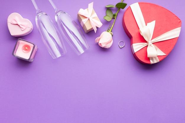 Flat lay arrangement with heart shaped box Free Photo