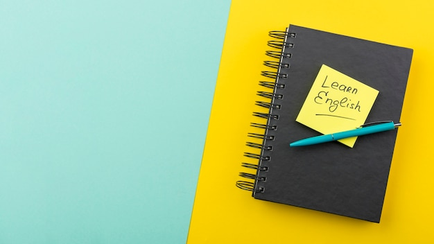 Flat lay arrangement with notebook and pen Free Photo