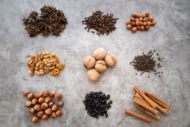 Flat lay arrangement with nuts on stucco background Free Photo