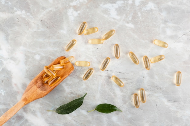 Flat lay arrangement with pills on marble table Free Photo
