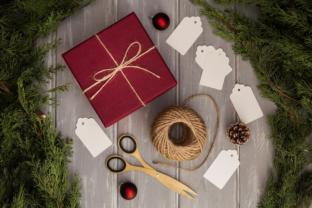 Flat lay arrangement with present and christmas tree Free Photo