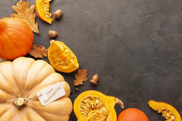 Flat lay arrangement with pumpkins on stucco background Free Photo