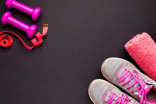 Flat lay arrangement with running shoes and towel Free Photo