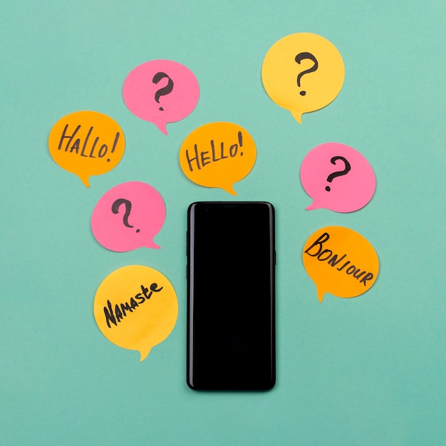 Flat lay arrangement with smartphone and sticky notes Free Photo