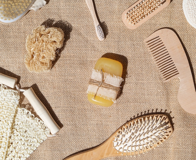 Flat lay arrangement with soap, comb and brushes Free Photo