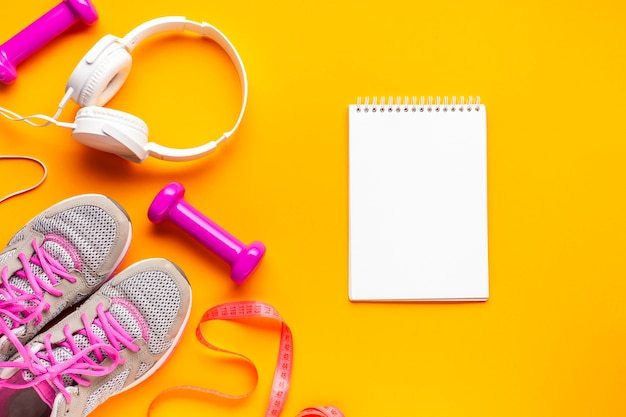 Flat lay arrangement with sports attributes and notebook Free Photo