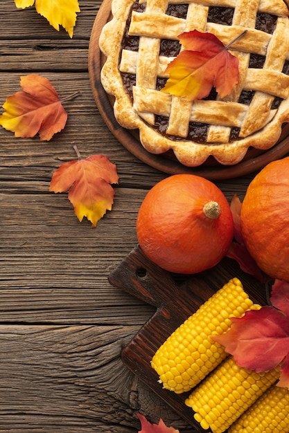 Flat lay arrangement with tasty pie and corn Free Photo