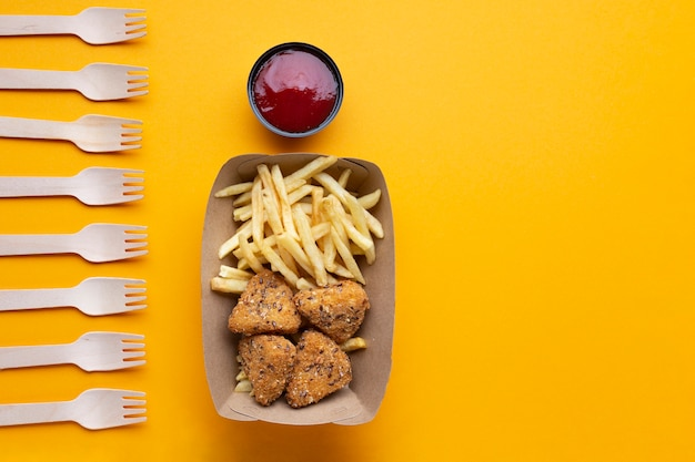 Flat lay arrangement with unhealthy food and forks Free Photo
