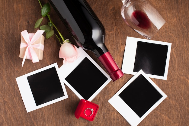 Flat lay arrangement with wine and photos Free Photo