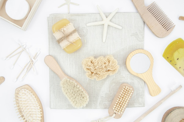 Flat lay arrangement with wooden brushes and mirror Free Photo