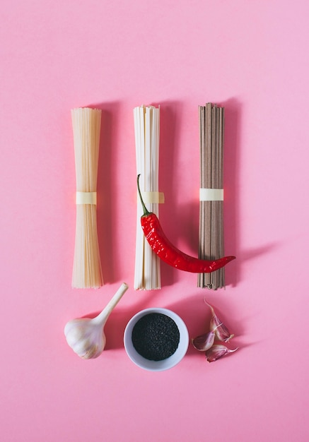 Flat lay asian noodles udon and soba, red chili, sesame and garlic Premium Photo