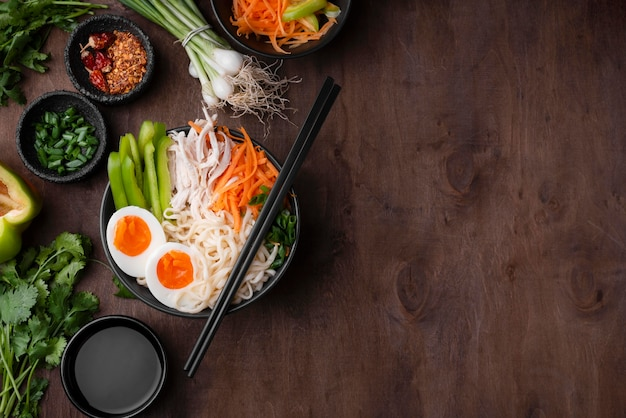 Flat lay of asian noodles with eggs and copy space Free Photo