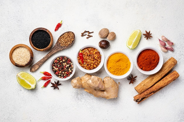 Flat lay assortment of asian food spices Free Photo