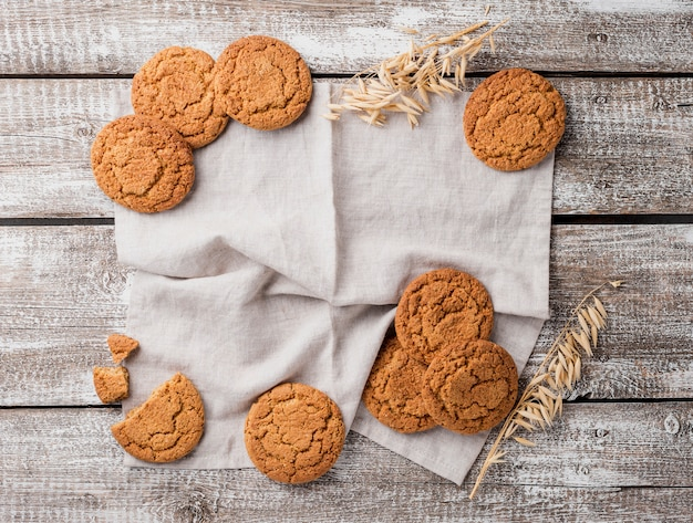 Flat lay assortment of biscuits and wheat Free Photo