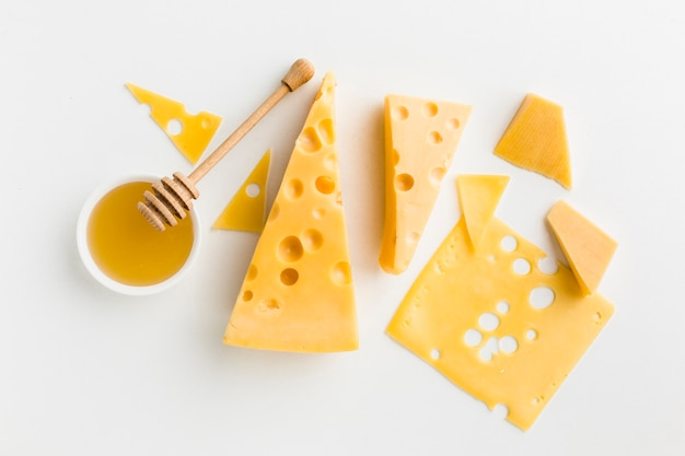 Flat lay assortment of cheese with honey Free Photo