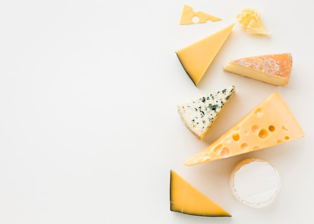 Flat lay assortment of gourmet cheese with copy space Free Photo