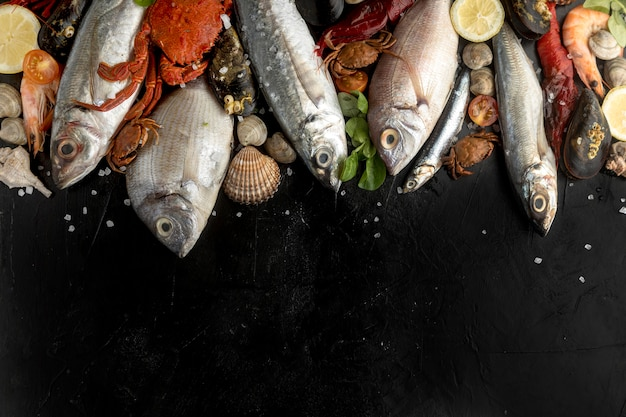 Flat lay of assortment of seafood with copy space Premium Photo