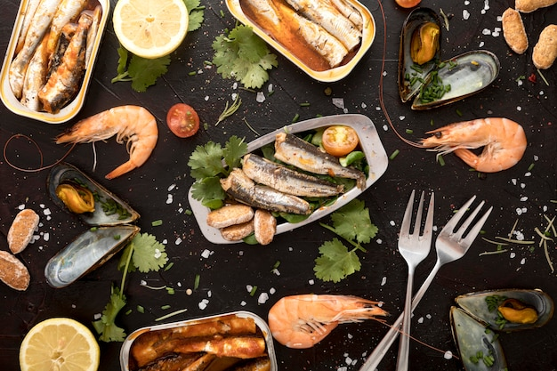 Flat lay of assortment of seafood with cutlery Free Photo