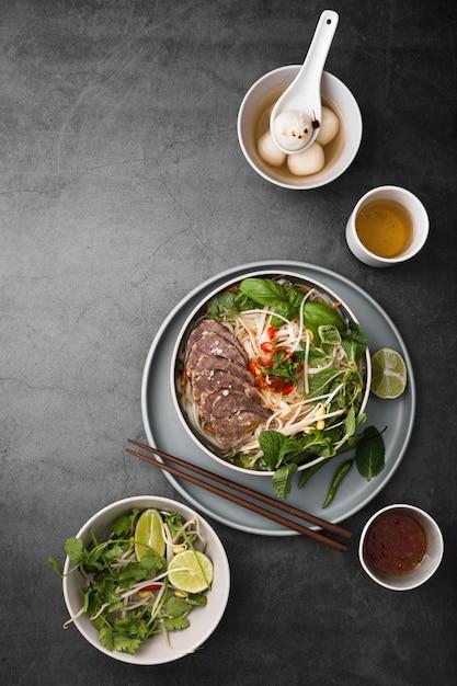 Flat lay of assortment of vietnamese food Free Photo