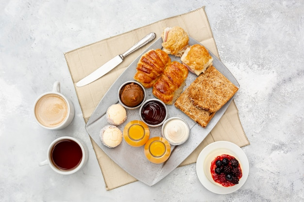 Flat lay assortment with delicious breakfast and cappuccino Free Photo