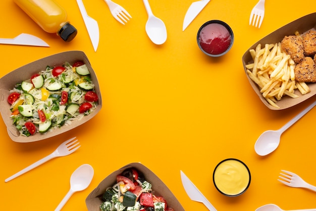 Flat lay assortment with food frame and tableware Free Photo
