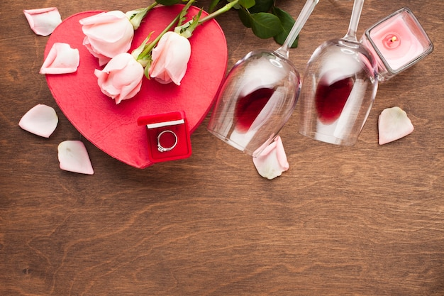 Flat lay assortment with pink rose petals Free Photo