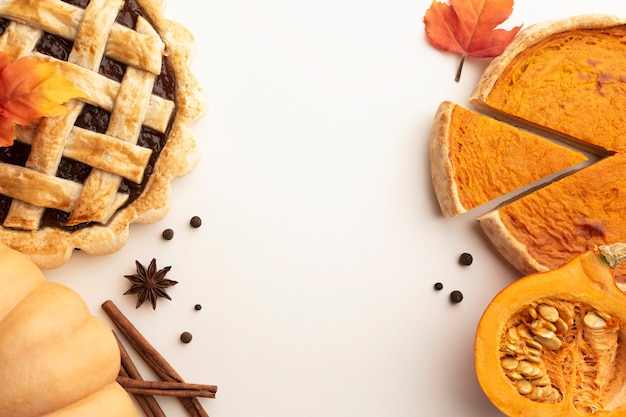 Flat lay assortment with with sliced pumpkin pie Free Photo