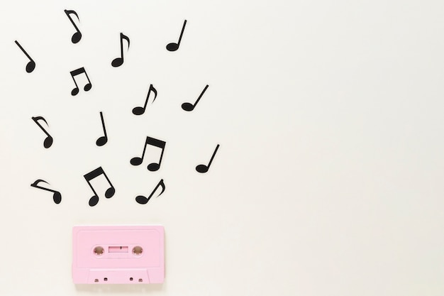 Flat lay audio cassette with musical notes Photo   Free Download
