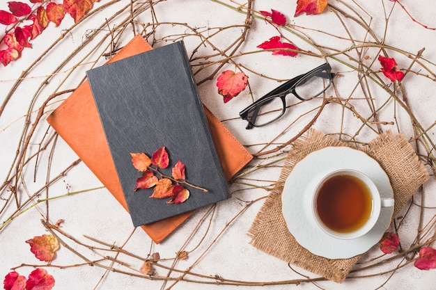 Flat lay autumn composition with coffee and notebooks Free Photo