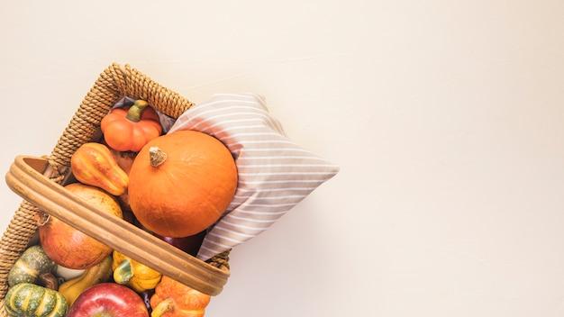 Flat lay autumn food in picnic basket Free Photo