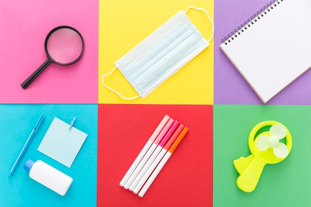 Flat lay of back to school supplies with pencils and notebook Free Photo