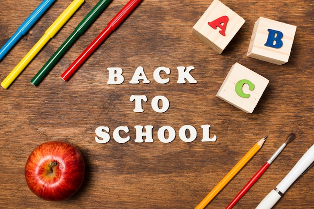 Flat lay back to school on wooden background Free Photo