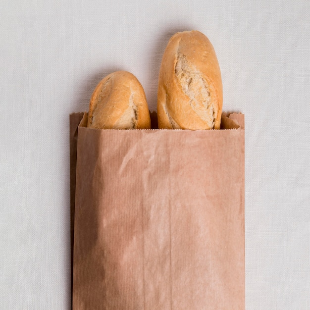 Flat lay baguettes in paper packaging Free Photo