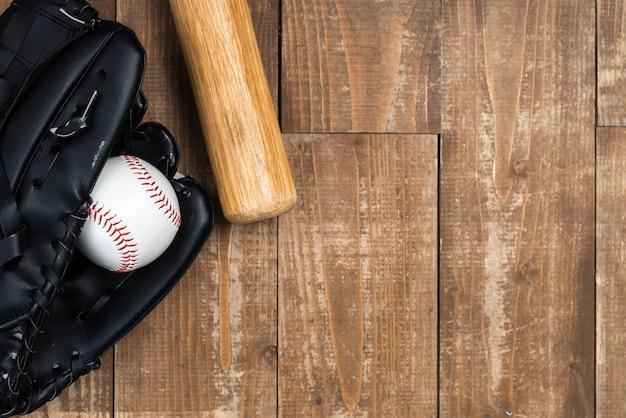 Flat lay of baseball bat with glove Free Photo