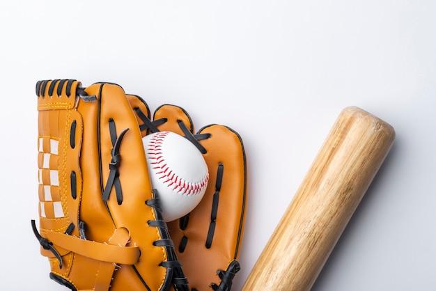 Flat lay of baseball and glvoe Free Photo