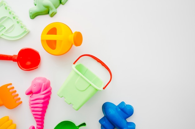 Flat lay beach toys for kids Free Photo