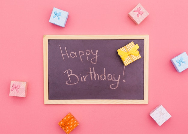Flat lay birthday composition with slate Free Photo