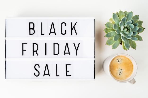 Flat lay black friday sale written on light box Free Photo